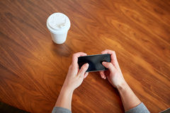 Close up of woman with smartphone and coffee Stock Photography