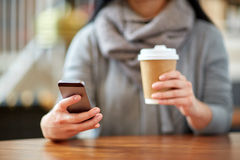 Close up of woman with smartphone and coffee Royalty Free Stock Photo
