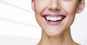 Close up of woman smiling against white background. Digital composite of Close up of woman smiling against white background Royalty Free Stock Photo