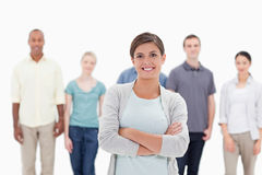 Close-up of a woman smiling and crossing her arms with people be Stock Photo