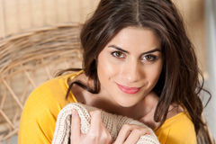 Close up of woman smiling and feeling cozy Royalty Free Stock Photo