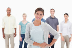 Close-up of a woman smiling with her hands on her hip with peopl Royalty Free Stock Image