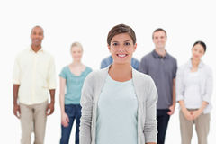 Close-up of a woman smiling with people behind her Royalty Free Stock Images