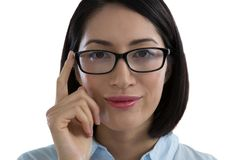 Close-up of woman in spectacle. Against white background Stock Images