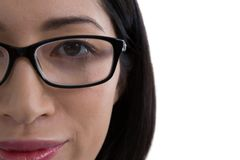 Close-up of woman in spectacle. Against white background Royalty Free Stock Photography