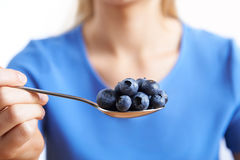 Close Up Of Woman With Spoonful Of Blueberries Royalty Free Stock Images