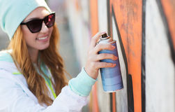 Close up of woman with spray paint making graffiti Stock Images