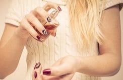 Close up on a woman spraying perfume Stock Photo