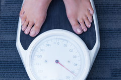 Close up of a woman standing on the scales Royalty Free Stock Image