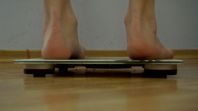 Close up of woman stands on scale for weighing stock footage
