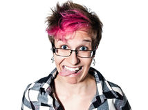 Close-up of woman sticking out tongue Royalty Free Stock Images
