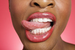 Close up of woman sticking out tongue Stock Photo
