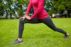 Close up of woman stretching leg outdoors Royalty Free Stock Photography