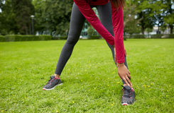 Close up of woman stretching leg outdoors Stock Photography