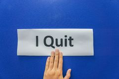 Woman submit resignation letter to quit the job with blue background royalty free stock photography