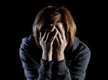 Close up woman suffering depression and stress alone in pain and grief Royalty Free Stock Photos