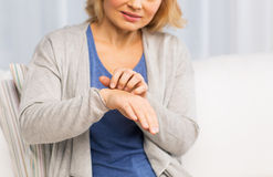 Close up of woman suffering from hand inch at home Royalty Free Stock Images