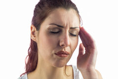 Close-up of woman suffering from headache. Against white background Stock Photos