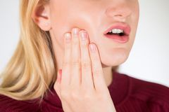 Studio Close Up Of Woman Suffering With Toothache Royalty Free Stock Images