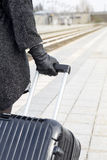 Close-up of woman with suitcase at train station Royalty Free Stock Photos