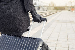 Close-up of woman with suitcase at train station Stock Image