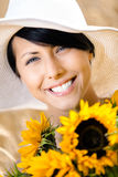 Close up of woman with sunflowers in the field Royalty Free Stock Images