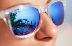 Close up of Woman In Sunglasses With Beach Reflection Stock Photography