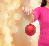 Close up of woman in sweater with christmas ball Royalty Free Stock Photos