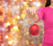Close up of woman in sweater with christmas ball Royalty Free Stock Photo