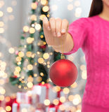 Close up of woman in sweater with christmas ball Royalty Free Stock Images