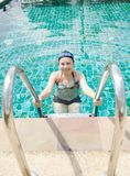 Close up woman swimming in swimming pool. Royalty Free Stock Photography