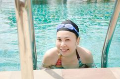 Close up woman swimming in swimming pool. Royalty Free Stock Photos