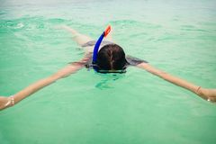 Close up woman swims with snorkeling mask in the ocean royalty free stock photography