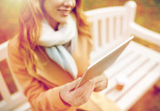 Close up of woman with tablet pc in autumn park Royalty Free Stock Photography