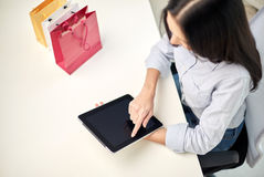 Close up of woman with tablet pc at office. Business, technology, sale, communication and people concept - close up of woman with tablet pc computer and shopping Royalty Free Stock Photos