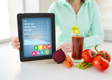 Close up of woman with tablet pc and vegetables Royalty Free Stock Photography