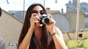 Close up of woman taking photos with old fashioned camera. Close up of beautiful brunette woman taking photos with old fashioned camera stock video footage