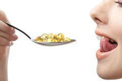 Close up of woman taking vitamins Royalty Free Stock Photography