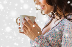Close up of woman with tea or coffee cup at home Stock Photos