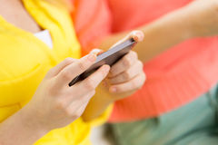 Close up of woman texting on smartphone at home Stock Photos