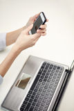 Close up of woman texting on smartphone at office Stock Photography