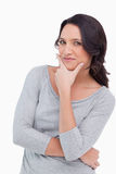 Close up of woman in thinkers pose. Against a white background Royalty Free Stock Photo
