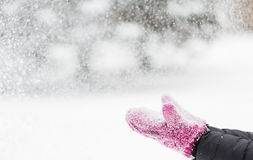 Close up of woman throwing snow outdoors Royalty Free Stock Image