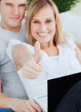 Close up of a woman with thumbs up Royalty Free Stock Images