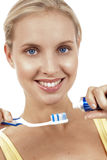 A close up of a woman with toothbrush. A close up of a beautiful woman with toothbrush Royalty Free Stock Photo