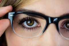 Close-up of woman touching her glasses Stock Images