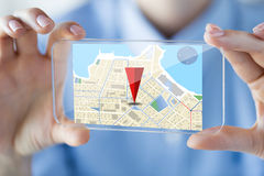 Close up of woman with transparent smartphone. Business, technology, navigation, location and people concept - close up of woman hand holding and showing Stock Photo
