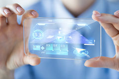 Close up of woman with transparent smartphone. Business, technology, navigation, location and people concept - close up of woman hand holding and showing Royalty Free Stock Images