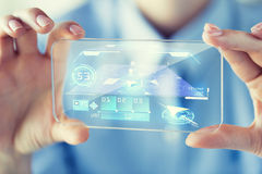 Close up of woman with transparent smartphone Stock Image