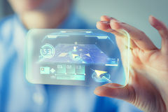 Close up of woman with transparent smartphone Royalty Free Stock Photo